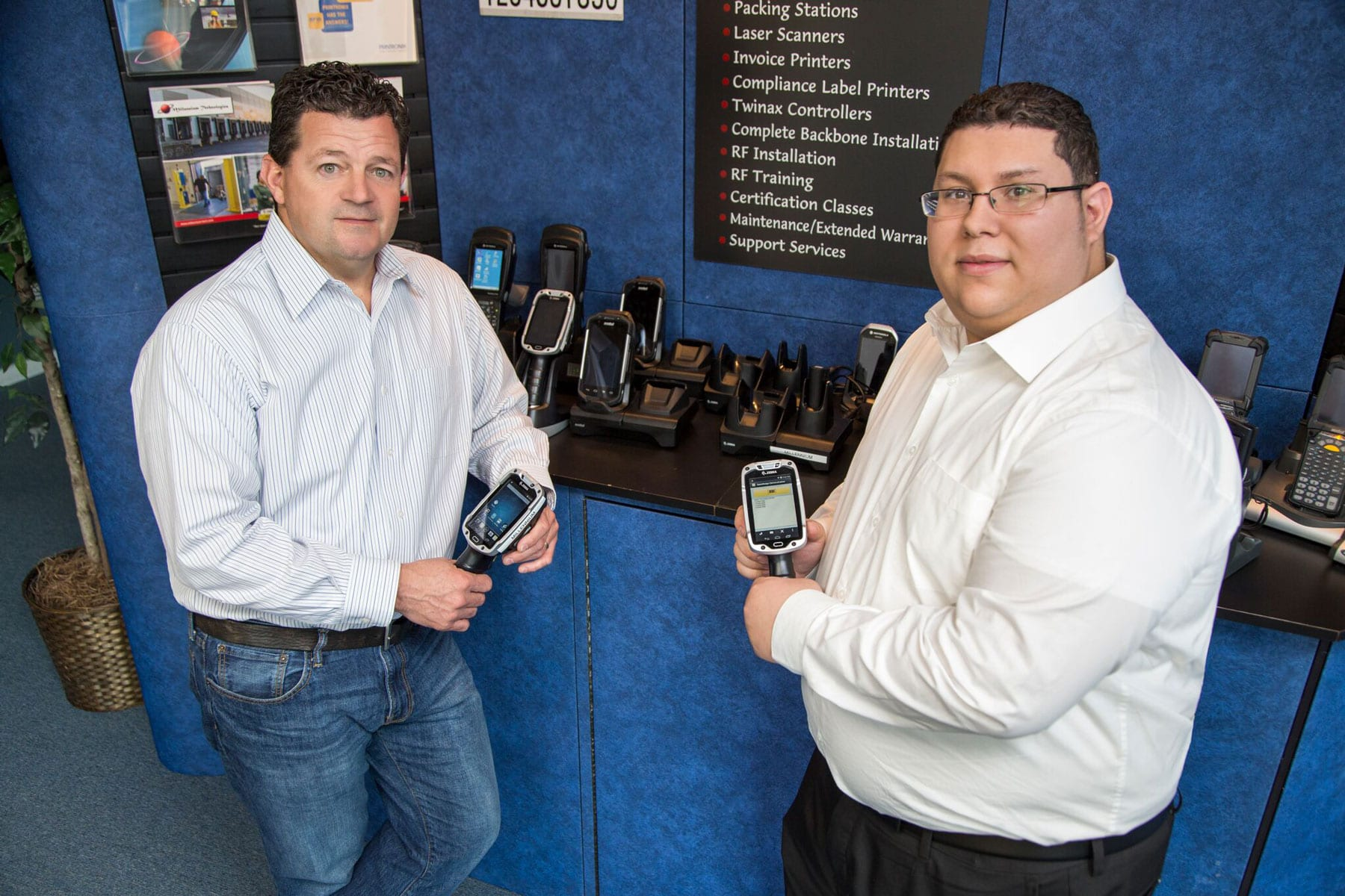 Millennium Technologies Employees Holding Scanners